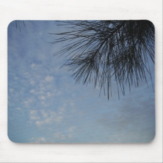 Evergreen Pine Against a Snowy Blue Sky Mousepads