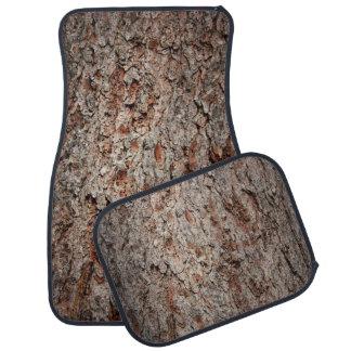 Evergreen tree trunk car mat