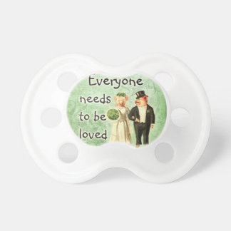 everyone needs love-- cute pig couple pacifiers