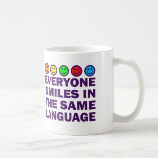 EVERYONE SMILES IN THE SAME LANGUAGE COFFEE MUG