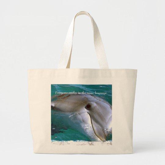 Everyone smiles in the same language. large tote bag