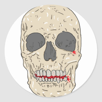 Evil, bloody and ravaged skull classic round sticker