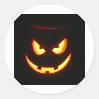 Evil grinning Halloween Pumpkin Face Classic Round Sticker