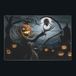 """Evil Pumpkinhead Halloween Placemat<br><div class=""""desc"""">This laminated double sided placemat has a cool scary pumpkinhead holding a skull on side 1 and has a creepy haunted house on side 2. It is one of many Halloween placemats available from Superkalifragilistic.</div>"""