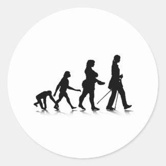 Evolution_8 humano pegatina redonda