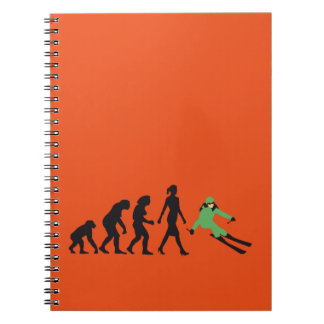 evolution OF woman skiing Spiral Notebook