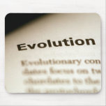Evolution text on page mouse pad