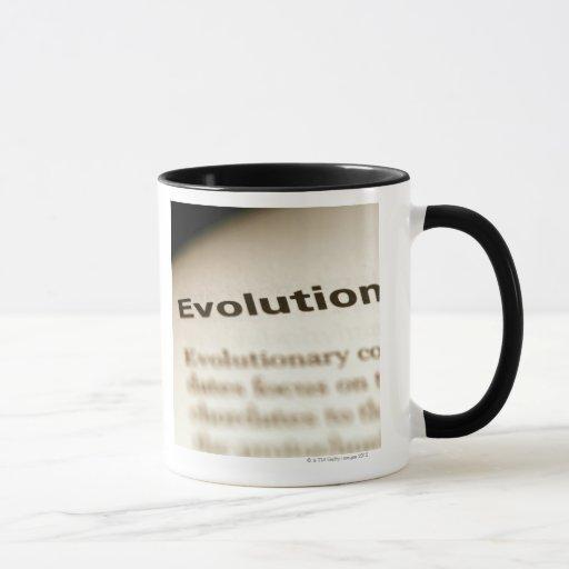 Evolution text on page mug