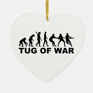 Evolution tug of war ceramic ornament