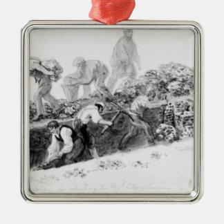 Excavación de un agujero para las fundaciones adorno navideño cuadrado de metal