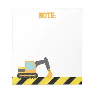 Excavador anaranjado, vehículo de la construcción, blocs de papel