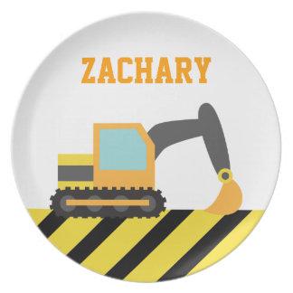 Excavador anaranjado, vehículo de la construcción, platos para fiestas