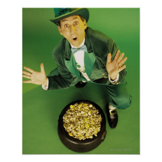 Excited leprechaun with pot of gold poster