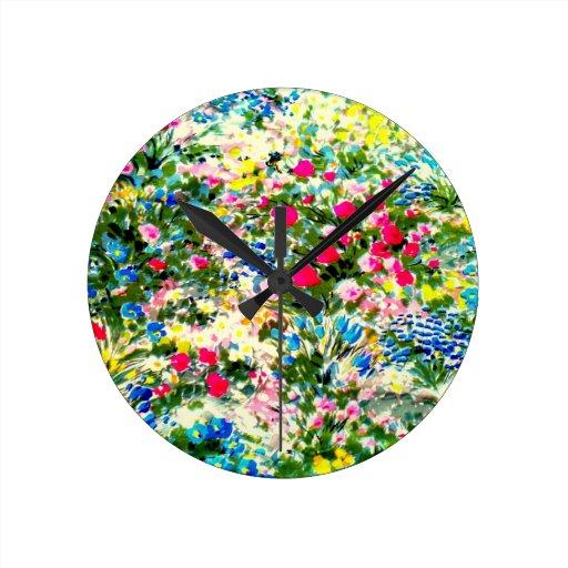 Exhibición impresionante de colores y de flores reloj