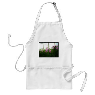 Exotic purple orchids hanging over green foliage adult apron