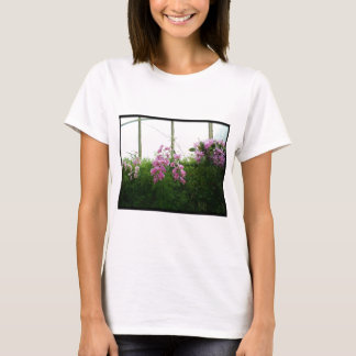 Exotic purple orchids hanging over green foliage T-Shirt