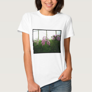 Exotic purple orchids hanging over green foliage t-shirts