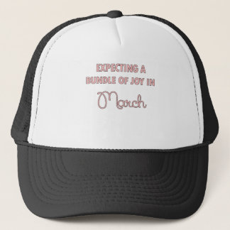 Expecting a bundle of joy in March pink.png Trucker Hat