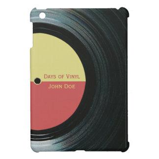 Expediente de negro vinilo con caso del iPad de la