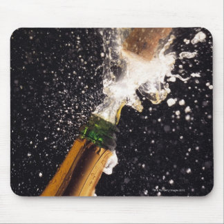 Exploding champagne bottle mouse pad