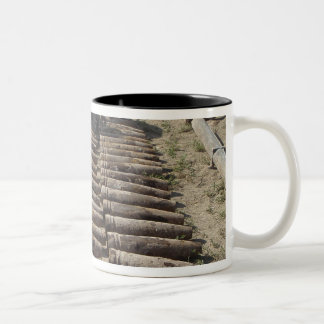 Explosive devices are identified and inventorie Two-Tone coffee mug