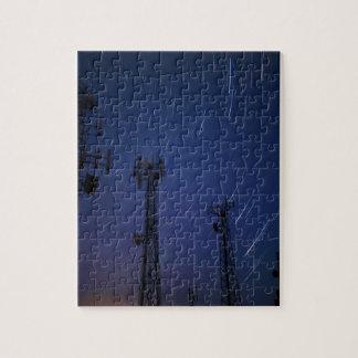 Exposición larga de los rastros de la estrella y puzzle con fotos