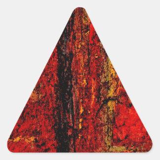 Extracto africano rojo de la estructura pegatina triangular