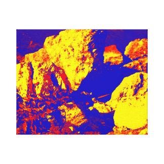 Extracto amarillo rojo pie Pierce de la roca azul Impresión En Lienzo Estirada