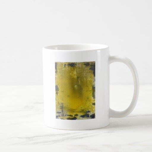 Extracto amarillo y gris taza de café