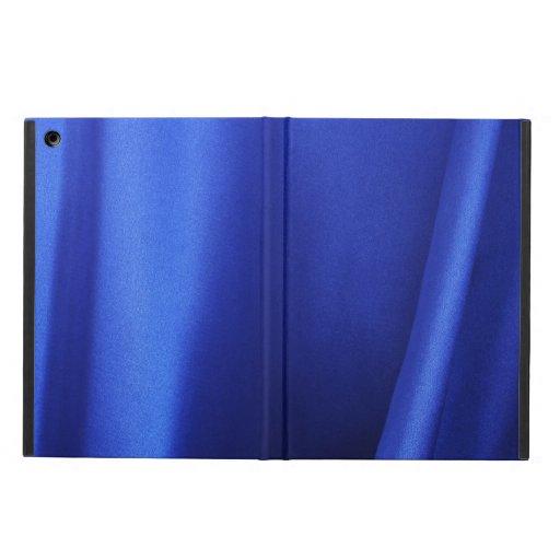 Extracto azul de la tela de seda que fluye