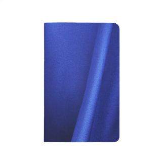 Extracto azul de la tela de seda que fluye cuaderno