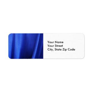 Extracto azul de la tela de seda que fluye etiqueta de remite