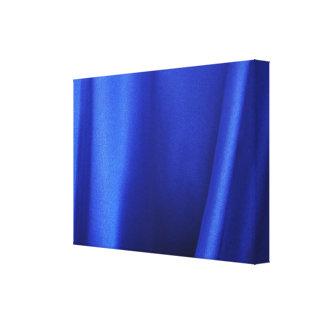 Extracto azul de la tela de seda que fluye impresion de lienzo