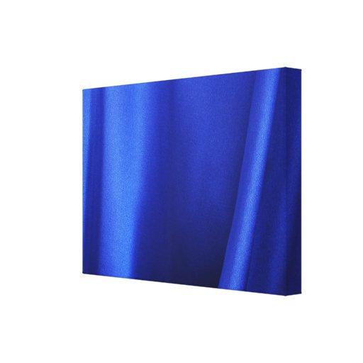 Extracto azul de la tela de seda que fluye impresiones en lona estiradas