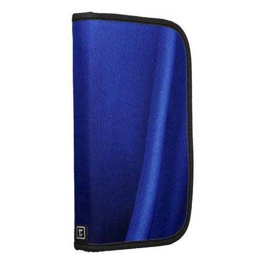 Extracto azul de la tela de seda que fluye planificador