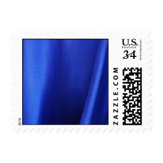 Extracto azul de la tela de seda que fluye - franqueo