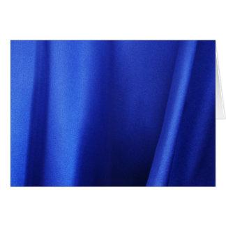 Extracto azul de la tela de seda que fluye tarjeta de felicitación