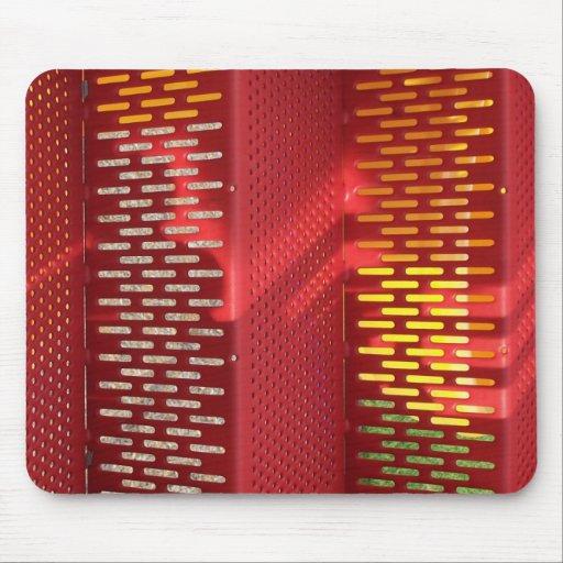 Extracto de acero rojo y amarillo descolorado de l tapetes de ratones