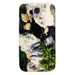Extracto de la roca con la planta verde painterly