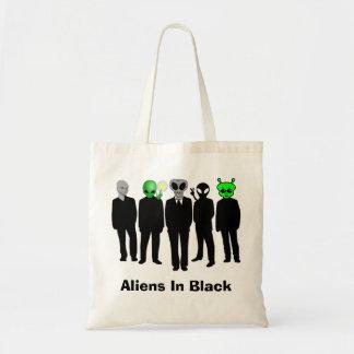 extranjeros en bolso negro bolsa