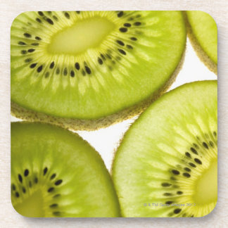 Extreme close-up of four pieces of sliced kiwi coaster