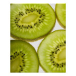 Extreme close-up of four pieces of sliced kiwi posters