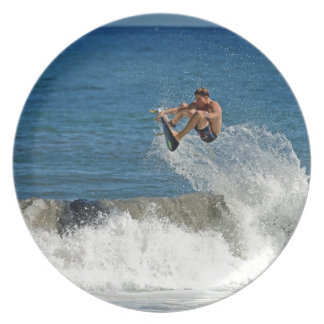 Extreme surfing huge air tropical waves plate