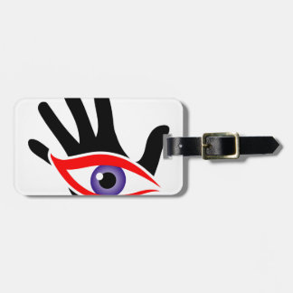 Eye emerging from a palm luggage tag