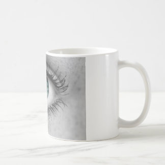 Eye looks to viewer concept macro coffee mug
