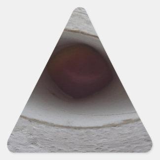 eye shaped hole, made of paper triangle sticker