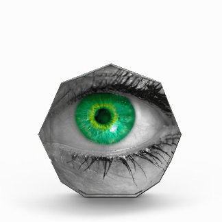 Eye with green iris looks at viewer concept macro award