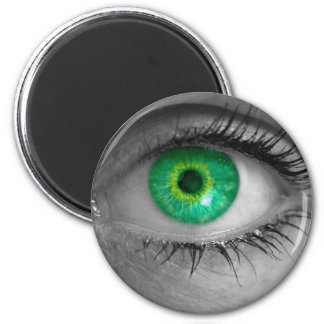 Eye with green iris looks at viewer concept macro magnet