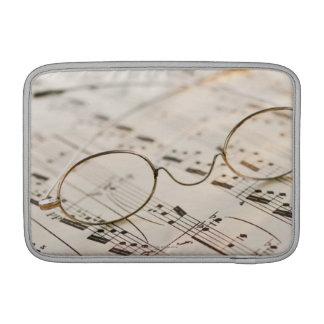 Eyeglasses on Sheet Music Sleeve For MacBook Air