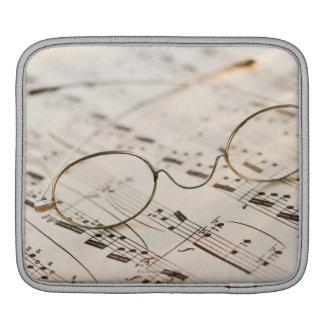 Eyeglasses on Sheet Music iPad Sleeves